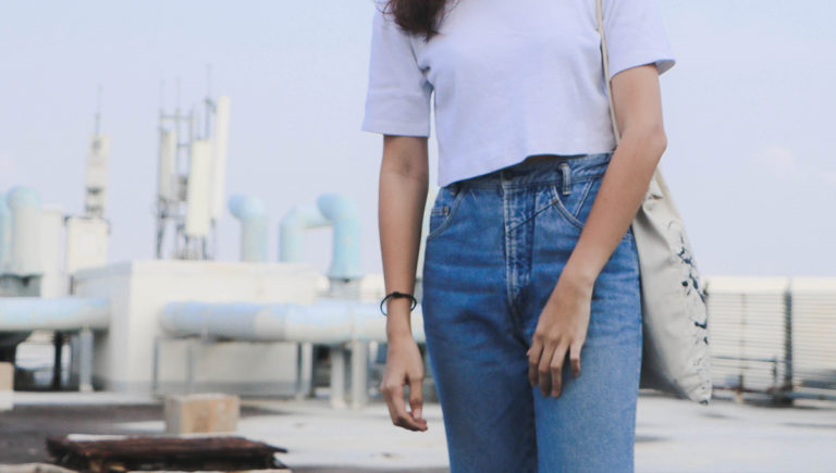 women in jean and white shirt in the city